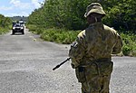 RAAF member protecting a vehicle control point during Cope North 2018.jpg