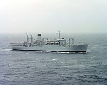 A grey ship with a helipad aft