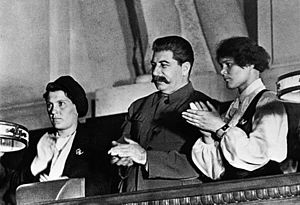 RIAN archive 377427 Stalin and famous collective farmers Demchenko and Angelina at the X Congress of the Young Communist League.jpg