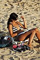 Reading at the beach (7080007897).jpg