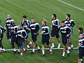 Real Madrid players worm up before game.JPG