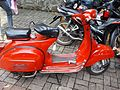 Red vespa scooters.jpg