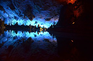 Reed Flute Cave - Lake inside the cave, with artificial lighting