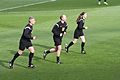 Referees warm up (8482526575).jpg