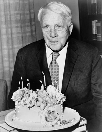 Robert Frost poses with his birthday cake on h...