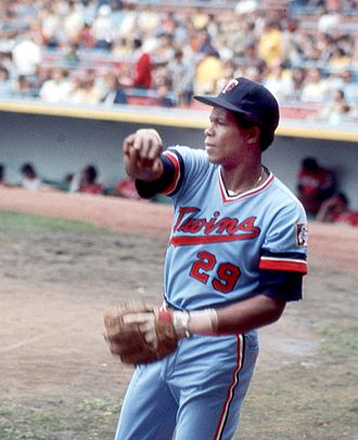 Rod Carew - Carew with the Minnesota Twins warming up before a game in Cleveland in 1975