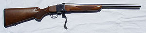 Falling-block action - Ruger No. 1 single-shot falling-block rifle in .243 Winchester with custom barrel with action open.