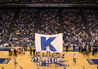 "University of Kentucky - The Kentucky cheerleaders at Rupp Arena performing the traditional ""Big K"" cheer during a basketball game. Seating Capacity of Rupp Arena is 23,500."
