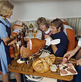 SAS DC-8-33. Interior of cabin. Service on board, air hostess serving Scandinavian Country Style Buffet.jpg