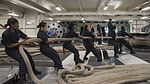 Sailors haul in mooring lines during a sea-and-anchor evolution aboard USS Ronald Reagan. (28989206921).jpg