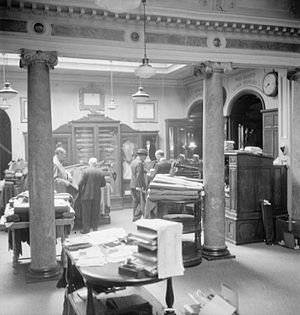 Henry Poole & Co - Customers examine the wares of Henry Poole and Co. in their 18th century showroom on Savile Row (1944)