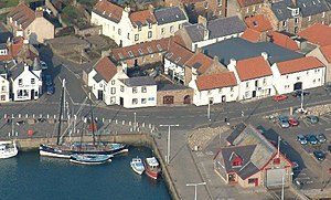 Scottish Fisheries Museum - Aerial view of the museum complex, with the twin masted Reaper seen berthed in the harbour to the left.