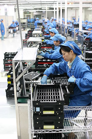 Workers perform final testing and QA before se...