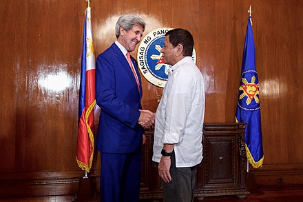 Duterte with then-U.S. Secretary of State John Kerry, July 26, 2016 Secretary Kerry Shakes Hands With Philippines President Duterte (28581522615).jpg