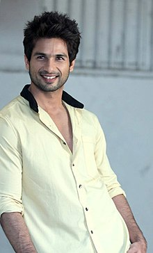 Shahid Kapoor is smiling at the camera.