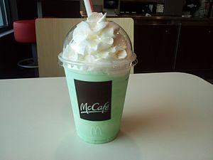Shamrock Shake - A customer's Shamrock Shake sitting on a table at McDonald's