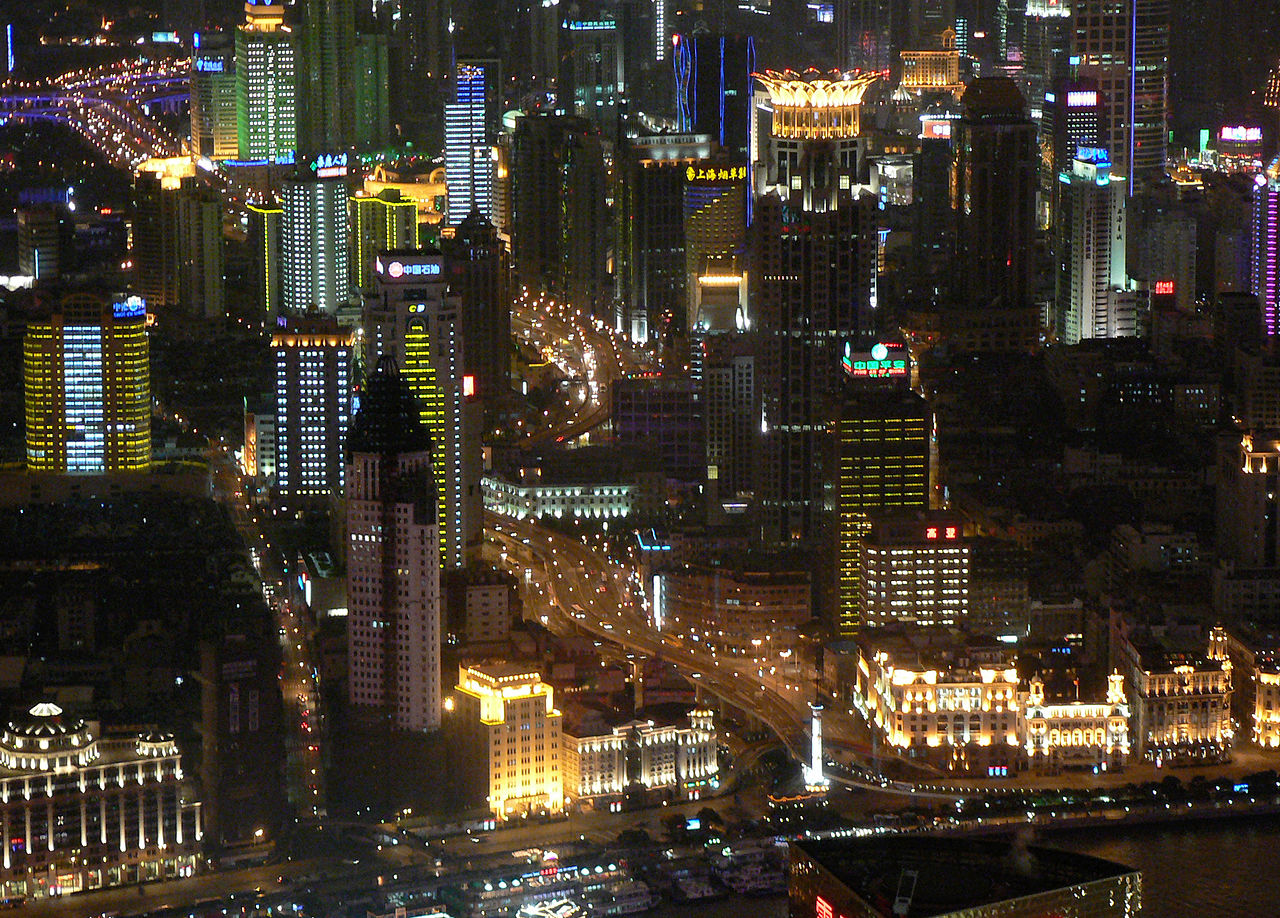 http://upload.wikimedia.org/wikipedia/commons/thumb/0/08/Shanghai_night_bund_skyscrapers.jpg/1280px-Shanghai_night_bund_skyscrapers.jpg