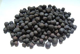Temagami Greenstone Belt - Iron ore pellets collected from the Sherman Mine railroad. Sherman Mine was the last mine to operate in the Temagami Greenstone Belt