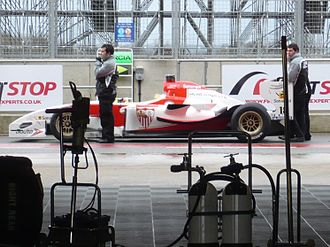 Sevilla FC (Superleague Formula team) - Sevilla's car in the pitlane at the 2010 Silverstone Superleague Formula round