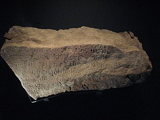 Early history of Singapore - A fragment of the Singapore Stone, inscribed with an unknown script, c 10th to 13th century.