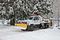 Snowplow-equipped truck fitted with two types of tire chains, TriMet 2008.jpg
