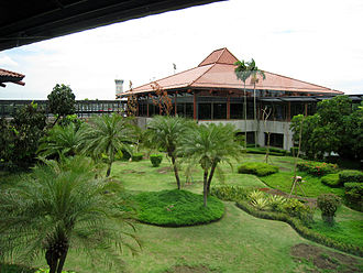Soekarno–Hatta International Airport - Tropical garden fill the spaces between Javanese-styled pendopo waiting and boarding pavilions.