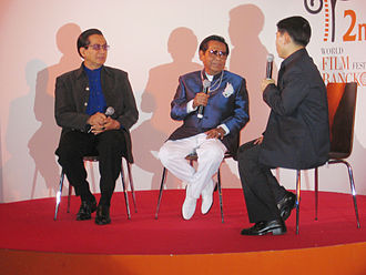"""World Film Festival of Bangkok - Thai actor Sombat Metanee and actor-director Dokdin Kanyamarn are interviewed during """"Thai Night"""" festivities at the World Film Festival of Bangkok. Dokdin's 1970s musical comedy, Ai Tui, starring Sombat and Petchara Chaowarat was screened that night."""
