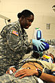 Staff Sgt. Claudia Bennett, left, a medic, from 7217th Medical Support Unit out of Miami, Fla., uses a bag valve mask on an injured Soldier on Fort Hunter Liggett, Calif., Aug. 2, 2011 110802-A-AJ827-497.jpg