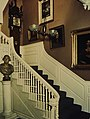 Staircase with painting of George Washington paintin, clock, and statue at Longfellow House Washington's Headquarters Natioinal (fb1ed9eef2844af9a25617199e636998).jpg