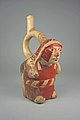 Stirrup Spout Bottle with Woman Carrying Burden MET 64.228.45.jpeg