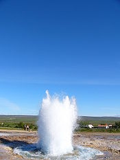 Geyser grows larger, reaching to the sky.