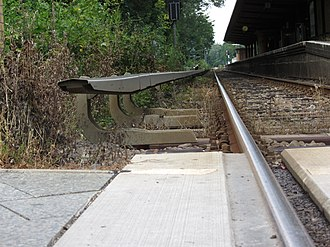Berlin S-Bahn - Berlin S-Bahn was converted from steam to third rail electrification starting in the late 1920s. The rail is bottom-contact. Seen here at the level crossing at Lichtenrade station