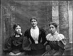Studio portrait of three young women (3640341010).jpg