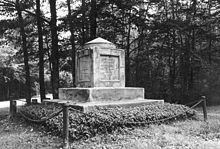 A black and white picture of a cube monument topped by a pyramid, both of stone, containing Sumner's remains