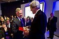 Switzerland Head of Department Foreign Affairs Burkhalter Presents Secretary Kerry Chocolate at the World Economic Forum in Davos (32368961345).jpg