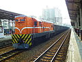 TRA R55 DL with Freight Cars at at Taoyuan Station 20101002.jpg