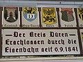 Tafel am Bahnhof Düren, 16. 06. 2012 - panoramio.jpg