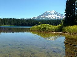 Takhlakh Lake reflects Mount Adams near the day use area at Takhlakh Lake Campground.