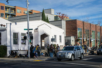 Hungry diners line up outside a performing arts center for a free Thanksgiving meal in Eugene, Oregon, in 2013 Thanksgiving Dinner at the WOW Hall.jpg