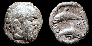 Thasos - silver tritartemorion struck in Thasos circa 411-404 BC. Satyr on the obverse and dolphins on the reverse