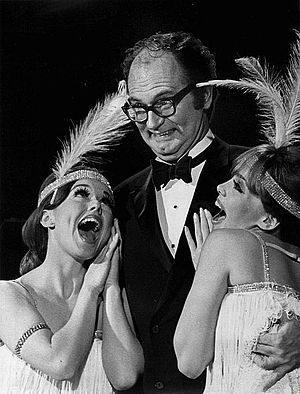 The Golddiggers - Charles Nelson Reilly flanked by two dancers in the season premiere of NBC's The Golddiggers (1970)
