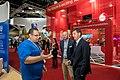 The Hon Angus Taylor MP with Harvey Stockbridge of CeBit talk with staff from Servers Australia at CeBit 2018.jpg