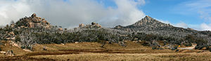 The Horn (Mount Buffalo) - Panoramic view across the Mt Buffalo plateau, with The Horn towards image right; the safety railing for walkers can be seen at the top