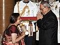 The President, Shri Pranab Mukherjee presenting the Padma Shri Award to Smt. Tripti Mukherjee, at a Civil Investiture Ceremony, at Rashtrapati Bhavan, in New Delhi on April 08, 2015.jpg