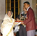 The President, Smt. Pratibha Patil presenting the Arjuna Award -2006 to Shri Jayanta Talukdar for Archery at a glittering function, in New Delhi on August 29, 2007.jpg