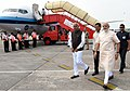 The Prime Minister, Shri Narendra Modi being received by the Governor of Assam, Shri Banwarilal Purohit and the Chief Minister of Assam, Shri Sarbananda Sonowal, on his arrival at Guwahati on August 01, 2017 (1).jpg