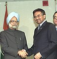 The Prime Minister Dr. Manmohan Singh shaking hands with the President of Pakistan Mr. Pervez Musharraf in New York on September 24, 2004.jpg