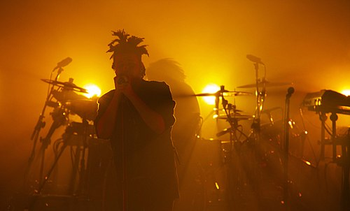 Tesfaye performing at Massey Hall in October 2013. The Weeknd at Massey Hall October 17, 2013 amber lighting.jpg