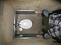 Tiny bathroom w- stone walls (2397199204).jpg