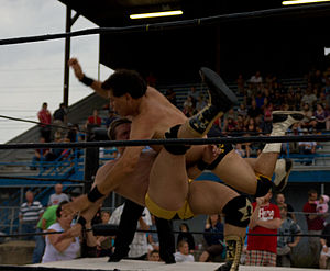 Tito Santana - Santana delivering a Flying forearm smash on his opponent in 2011